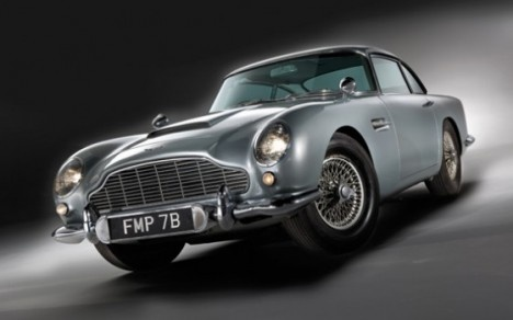 """A US car enthusiast has bought James Bond's famous Aston Martin car at auction for more than four million dollars. The 1964 silver Aston Martin DB5 was driven by Sean Connery in the films """"Goldfinger"""" (1964) and """"Thunderball"""" (1965). 25"""