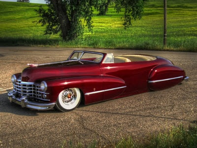 Different color, but rawr. So sleek. I love Cadillacs.