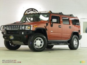 HUMMER H2 SUV IN SUNSET ORANGE METALLIC CAR